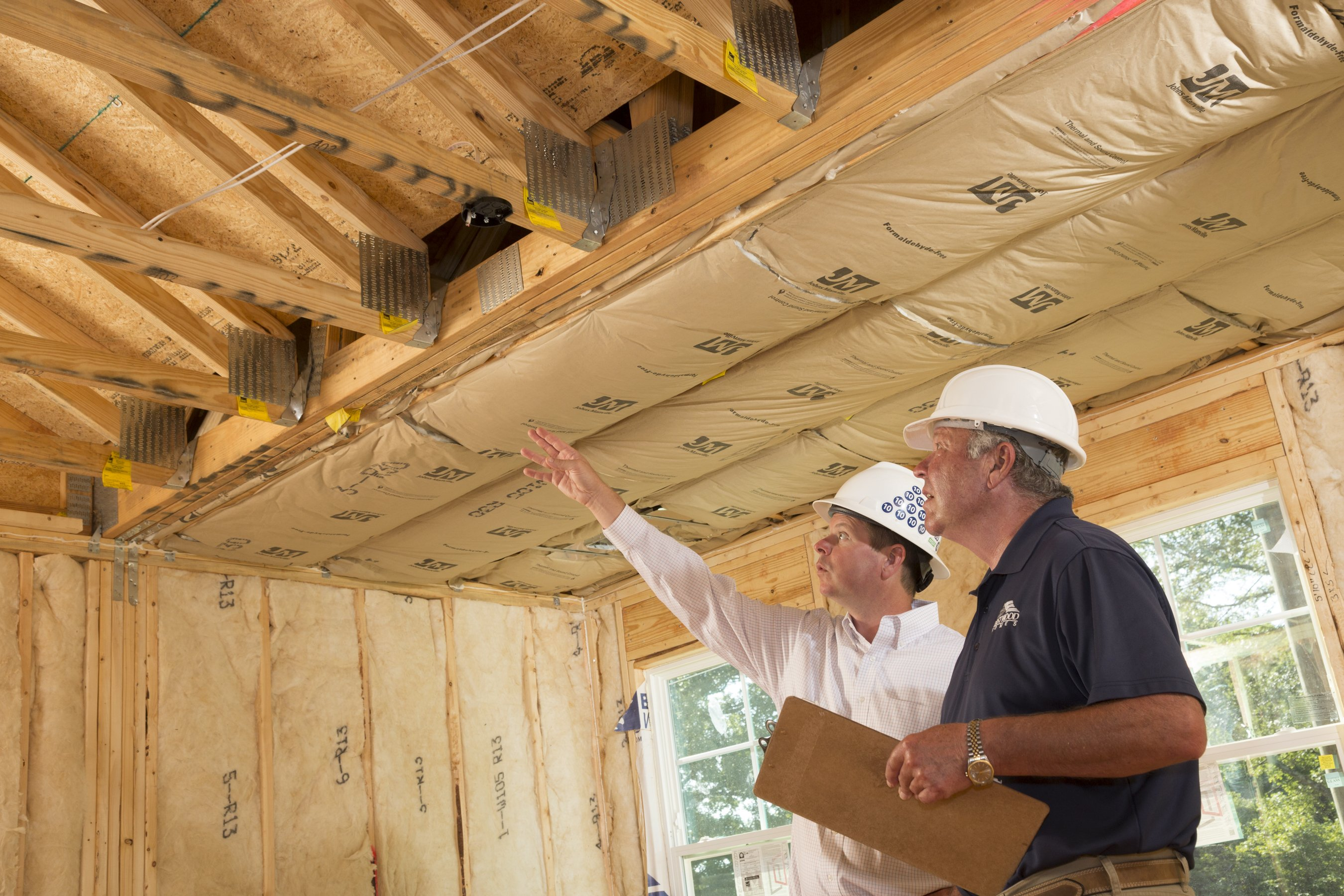 Eastwood owners Joe and Clark Stewart examine a house in framing