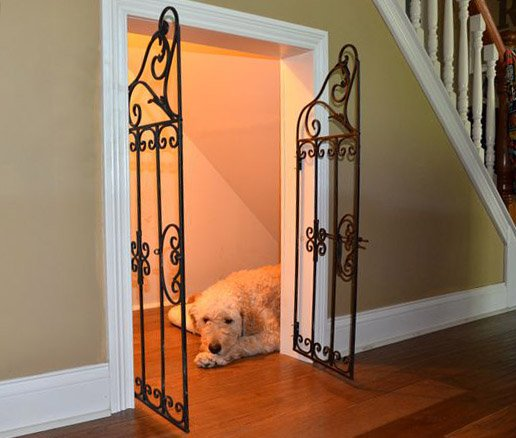 A dog house under the stairs